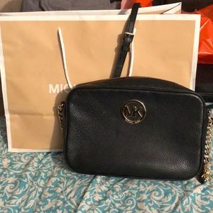 Black and gold Michael Kors cross body purse